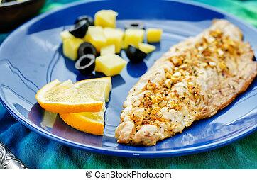 mackerel with garlic and lemon marinated. Moroccan dish....