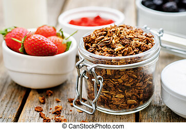 granola with yogurt, nuts, goji berries and strawberries....