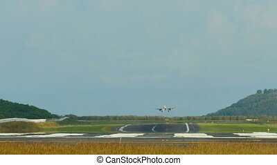 Landing - Jet airplane touch down the runway, International...