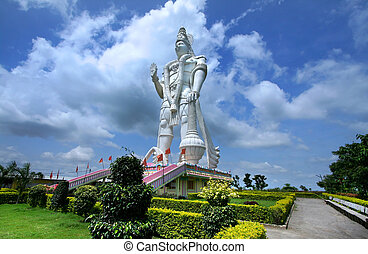 Hanuman - Huge mighty Hanuman statue against cloudy skies in...