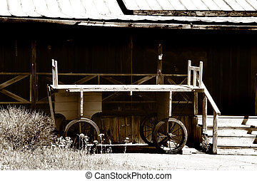 Old Wagon - Old wagon in front of a rustic house in sepia