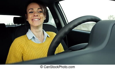 woman in car on the phone - Happy girl smiling talking on...