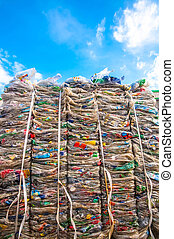 Plastic waste with sky - Plastic waste of a supermarket for...