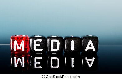 media - text Media on red and black dices on blue background...