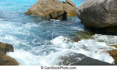 Ocean shore - Waves breaking near a rocky shore