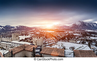 panoramic shot of sunset over the  snowy Alps next to Salzburg