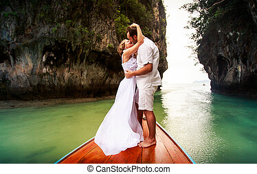groom kissing and embracing bride - blonde bride kissing and...