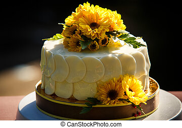 white creamy delicious cake decorated with yellow flowers...