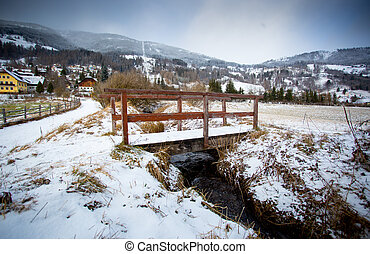 old wooden bridge over river in Austrian Alps - Beautiful...