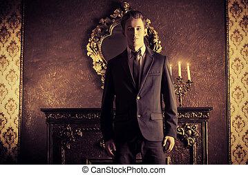 financier - Handsome respectable man in elegant suit stands...