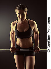 powerlifting - Strong young woman with beautiful athletic...