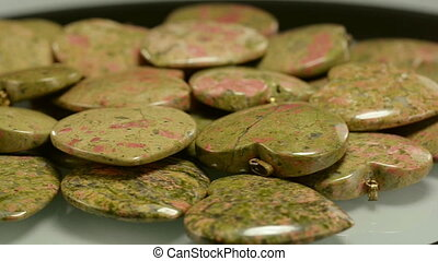 Unakite carved hearts - Carving unakite hearts are rotating...