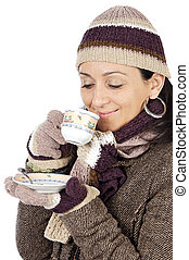 attractive lady sheltered for the winter drinking a tea cup...