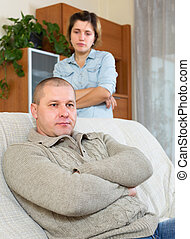 Family quarrel. Sadness man against unhappy young woman in...