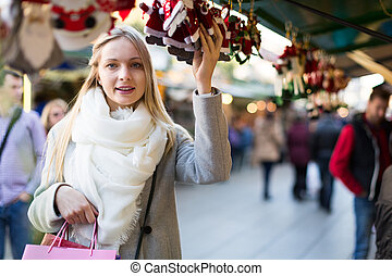 female near counter with xmas gifts - Portrait of european...