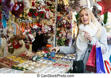female near counter with xmas gifts - Portrait of female...