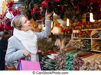 Beautiful woman at Christmas market - Happy blonde young...