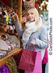 Beautiful woman at Christmas market - Young smiling woman...
