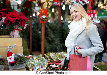 girl chooses mistletoe - Young girl staying near counter...