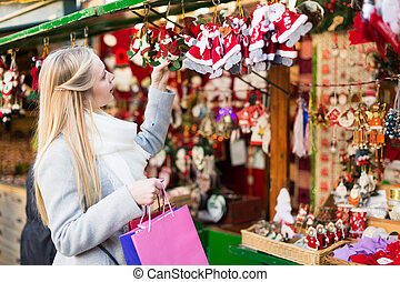 female near counter with xmas gifts - Portrait of beautiful...