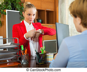 Nervous boss listening to excuses from clerk at office