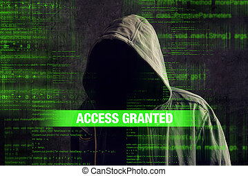 Faceless hooded anonymous computer hacker - Access granted...