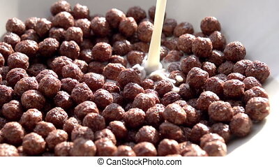 Milk Pouring in Chocolate Corn Ball - Jet milk slowly...