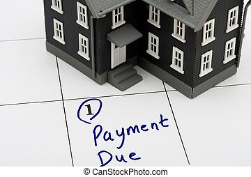 Mortgage Payment - A model house on calendar background,...
