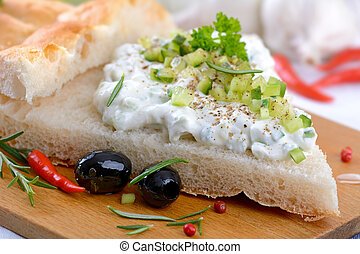 Tzatziki - Fresh Greek tzatziki on pita bread, served with...