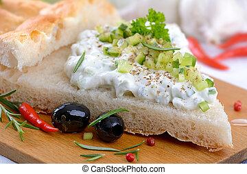 Tzatziki - Fresh Greek tzatziki on pita bread, served with...