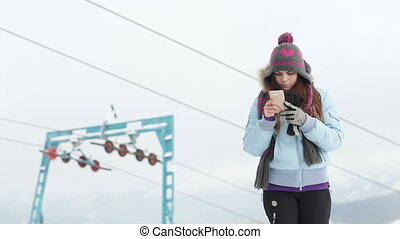 Self ski lift - Girl with your smartphone on background lift