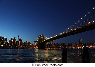 downtown manhattan, brooklyn bridge new york at night during...