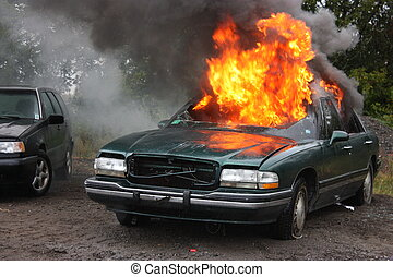 Automobile fire. - Fire Fighters on the scene of an auto...