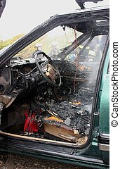 After the fire. - An auto interior after the fire is put...