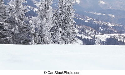 Mountain slope in snow - Skiing slope near ski lifts