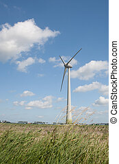 Windturbine in the farmland producing alternative energy