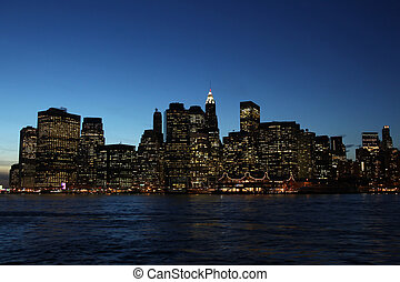 downtown manhattan, new york at night during blue hour