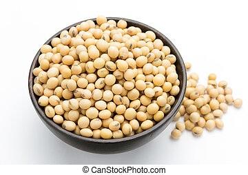 Soybeans on wooden bowl isolated on a white background.