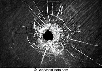 Bullet shot cracked hole on broken window glass - Bullet...