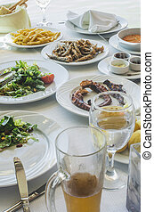 Table in greek restaurant Salat and fish Greece, Athens,...