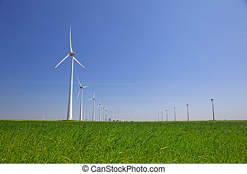 Windturbine in the farmland with a clear blue sky
