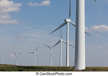 Two wind turbines near the coast producing alternative...
