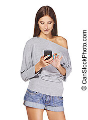 Teen girl text messaging on her mobile - Smiling teen girl...