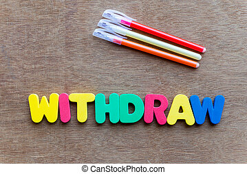 withdraw colorful word on the wooden background