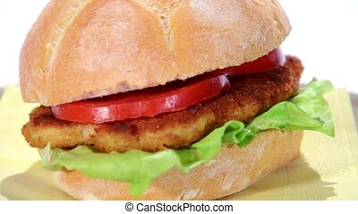 chicken cutlet and tomato sandwich