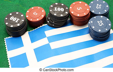 chips for gambling over the flag of Greece - many fiches...