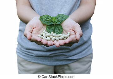 organic capsule medicine for good health - Hand holding...