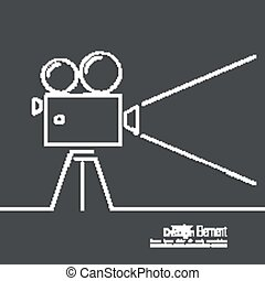 Old movie camera with reel on a dark background and a ray of...