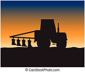 Silhouette of the tractor in field - Silhouette of the...