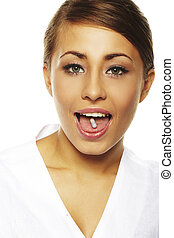 young woman holding pill by her mouth before taking it
